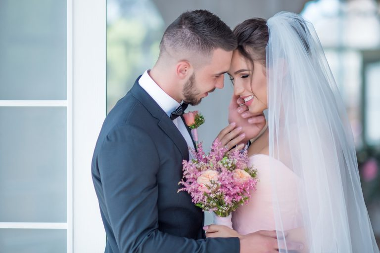 Groom and bride capturing their wedding moments